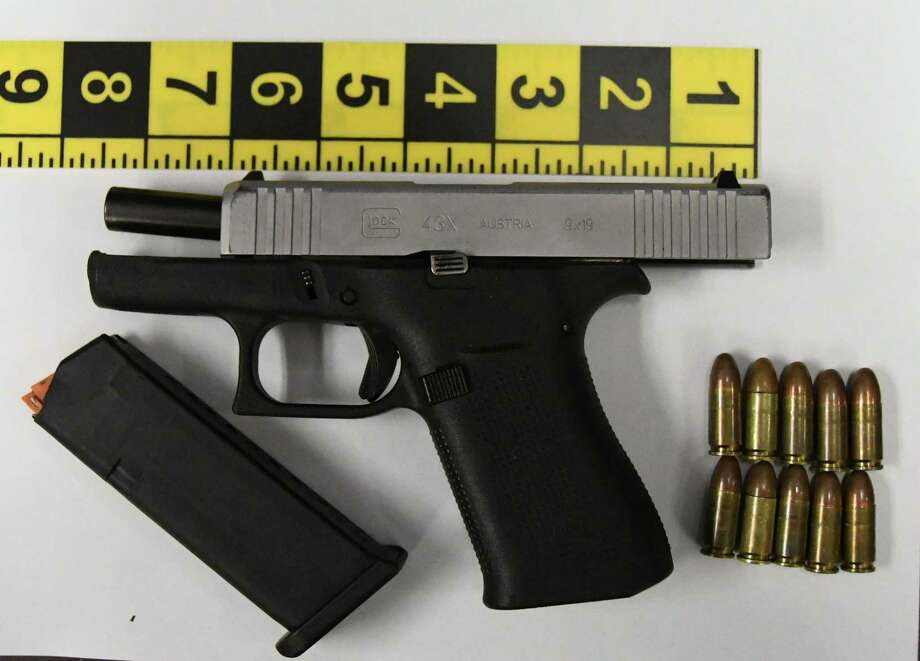 This stolen 9mm Glock semiautomatic handgun was found in the possession of a 17-year-oold Stamford boy over the weekend. Photo: Stamford Police Department / Contributed