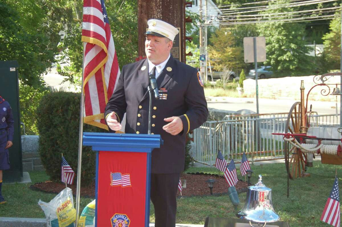 New York City firefighter Joe McHugh, speaking here at the annual Sept. 11 memorial ceremony in 2018 in Greenwich, was named chief of the Greenwich Fire Department on Thursday morning. He will be sworn in on Monday morning.