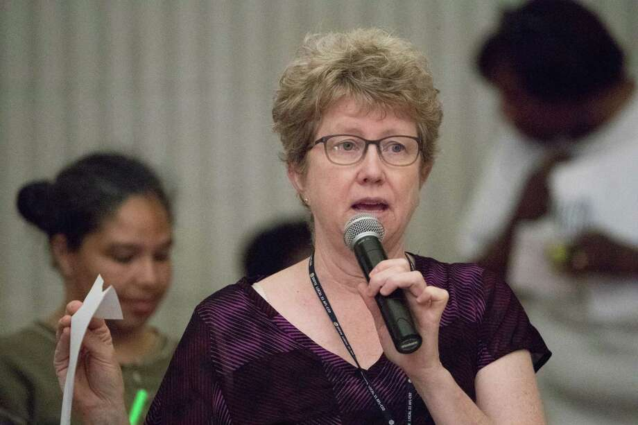 Amy Brownell of the San Francisco Department of Public Health speaks at a community meeting in 2018 about the Hunters Point Naval Shipyard and pollution. Photo: Paul Kuroda / Special To The Chronicle 2018 / online_yes