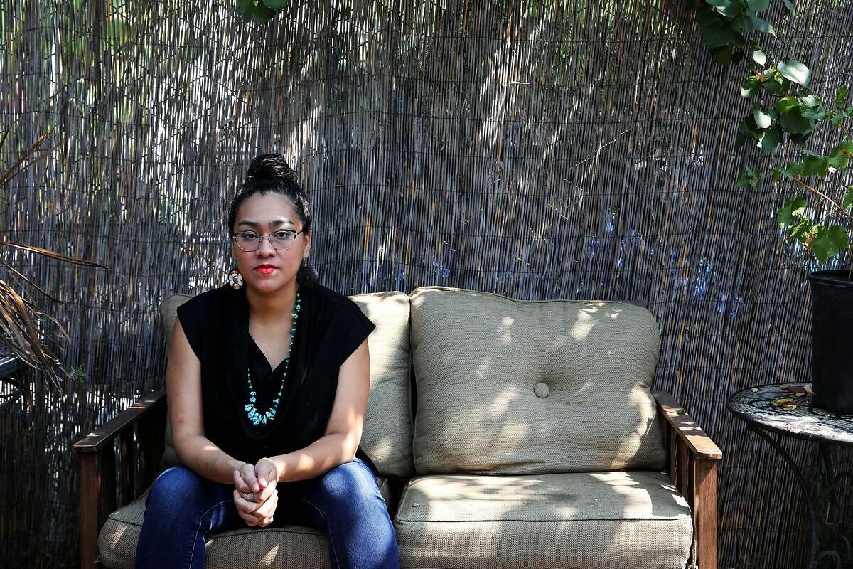 Lil Milagro Henriquez poses for a portrait at her home on Saturday, August 22, 2020, in Oakland, Calif. Henriquez is the executive director of Mycelium Youth Network, a STEM education organization with focuses on climate and ancestral knowledge.