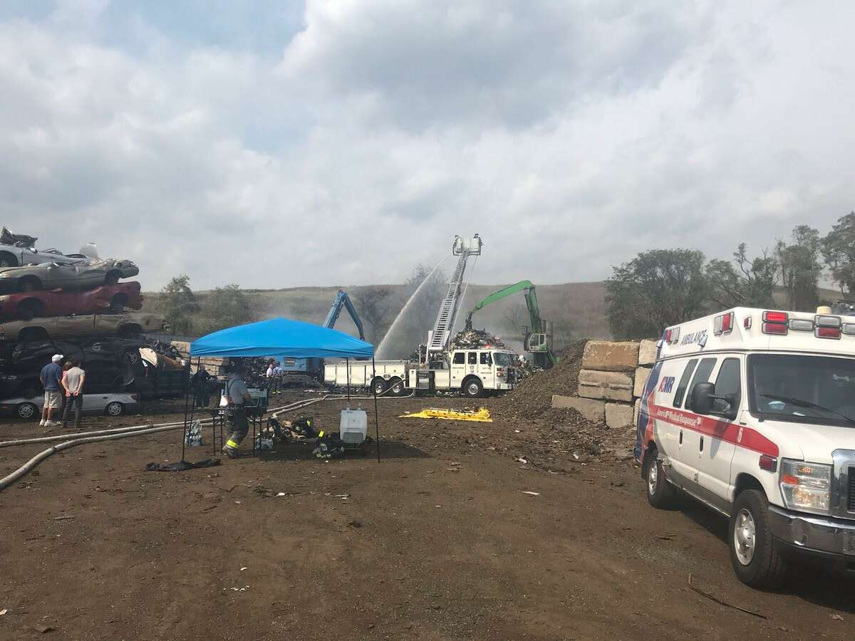 Firefighters are battling a junkyard fire of several vehicles at Chuck and Eddie's on Thursday, Aug. 27, 2020. The fire broke out just before 1 p.m. at 190 Middletown Ave. in New Haven.