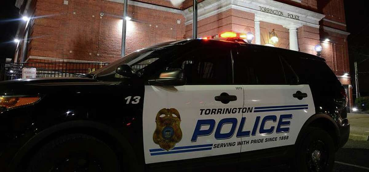 File photo of a Torrington, Conn., police cruiser in front of police headquarters.