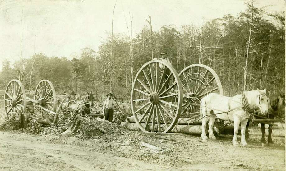Loggers ready overpack logging wheels to haul cut logs out of the forest. (Manistee County Historical Museum photo)