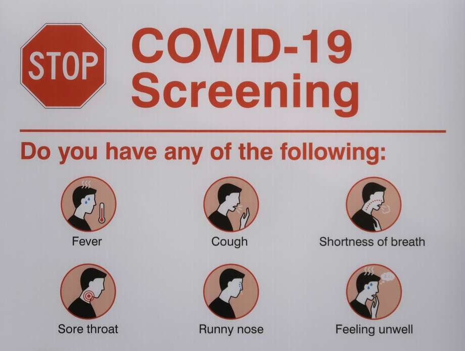Informational sign showing what symptoms may be involved in a case of COVID-19. Photo: Chris Jongkind/Getty Images / ©2020 Chris Jongkind