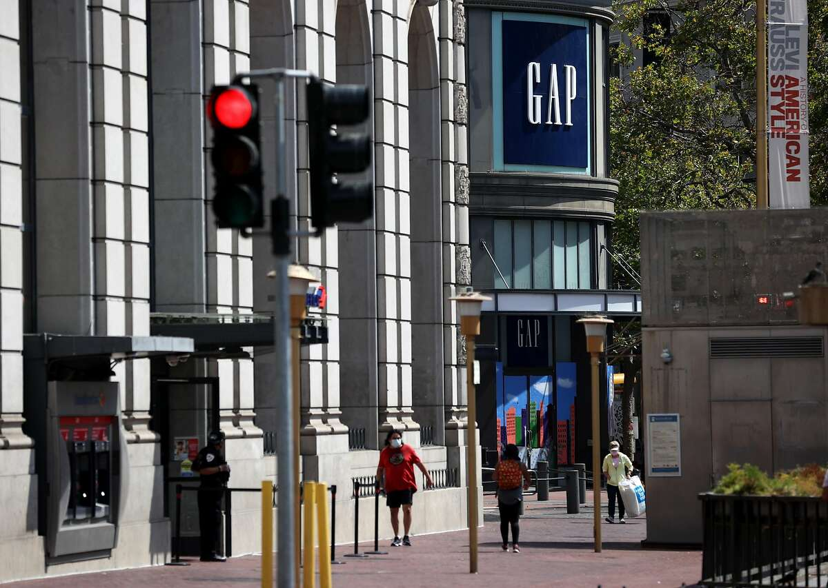 SAN FRANCISCO, CALIFORNIA - AUGUST 18: Pedestrians walk by the closed GAP flagship store on August 18, 2020 in San Francisco, California. Gap Inc. announced that they will permanently close its flagship store in San Francisco and all but one store in the city due to a drop in retail sales as the coronavirus COVID-19 pandemic continues. (Photo by Justin Sullivan/Getty Images)