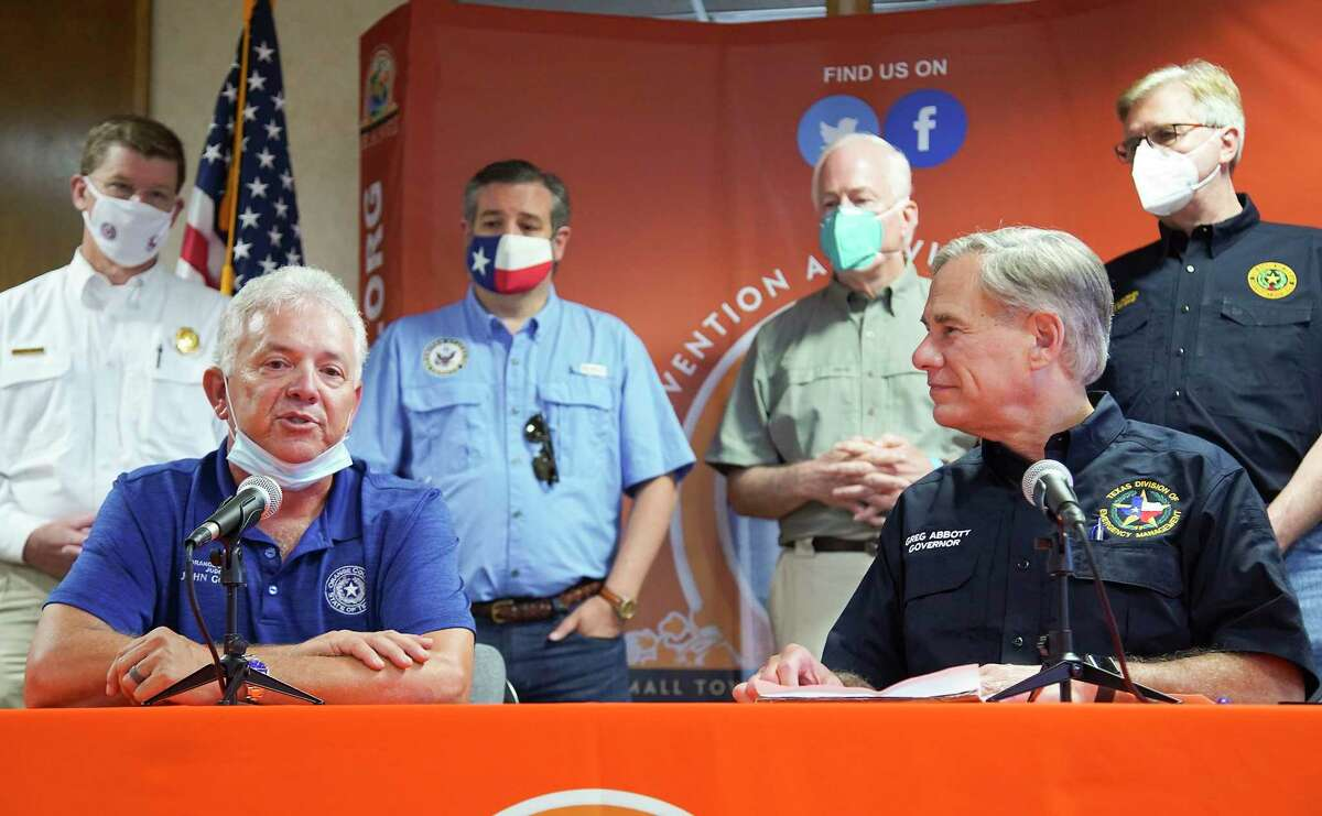 Orange County Judge John Gothia, left, addresses the media with Texas Gov. Greg Abbott and other members of local and national government about the area's response to Hurricane Laura in Orange on Thursday, Aug. 27, 2020.