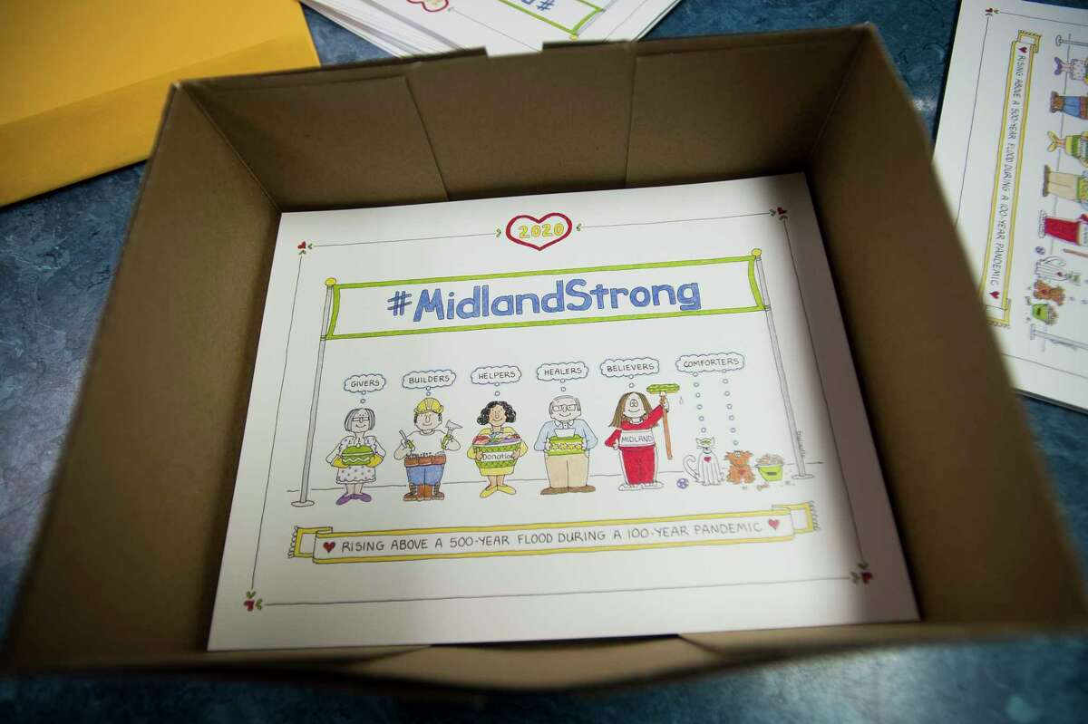 Original designs by cartoonist Cathy Guisewite were used to create items for a fundraiser for United Way of Midland County's flood recovery efforts. (Katy Kildee/kkildee@mdn.net)