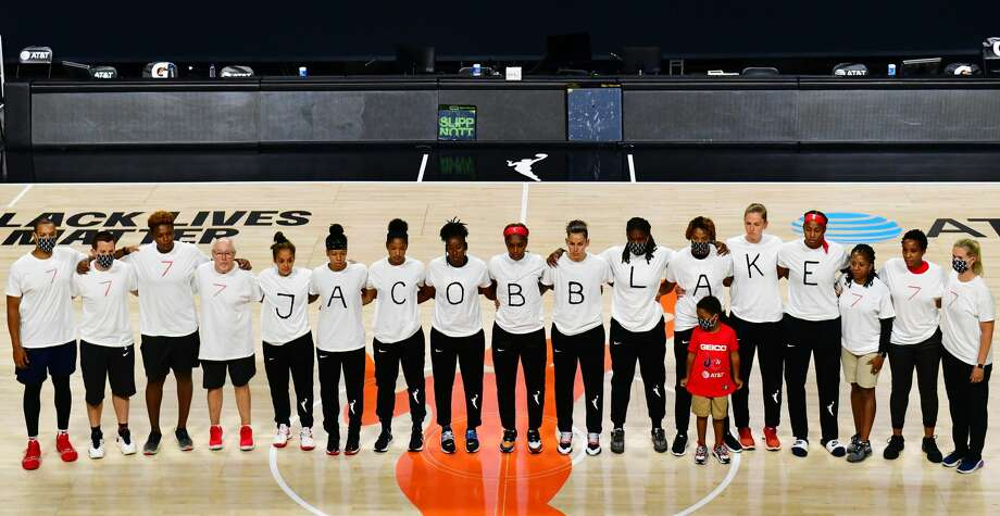 After the WNBA announcement of the postponed games for the evening, the Washington Mystics each wear white T-shirts with seven bullets on the back protesting the shooting of Jacob Blake by Kenosha, Wisconsin police.(Photo by Julio Aguilar/Getty Images) Photo: Julio Aguilar/Getty Images / 2020 Julio Aguilar