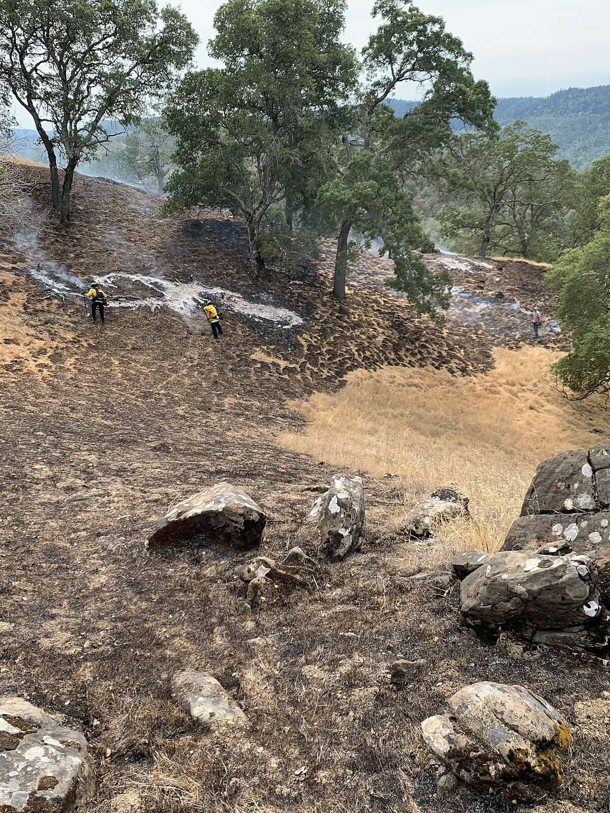 Shots of the wildfires in Pope Valley, in Napa County, where local residents bulldozed their own fire break and saved countless homes.