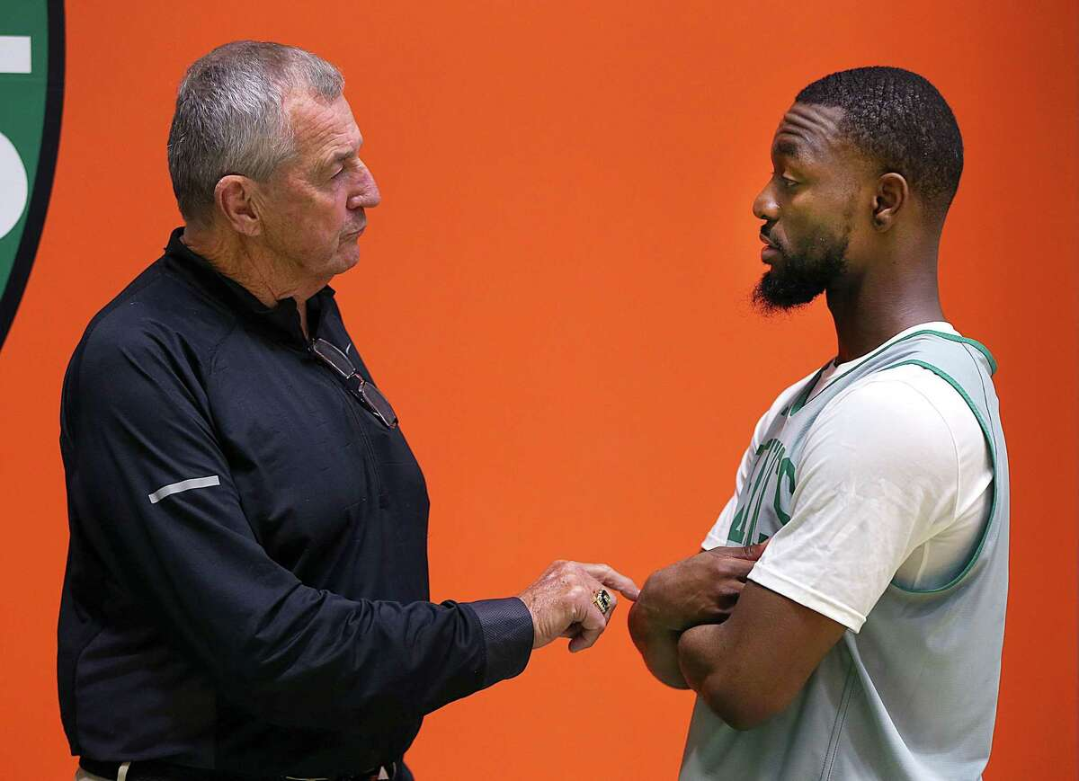 BOSTON - OCTOBER 2: College basketball coach Jim Calhoun makes a point as he talks with the Celtics' Kemba Walker during Boston Celtics training camp at the Auerbach Center in the Brighton neighborhood of Boston on Oct. 2, 2019. (Photo by John Tlumacki/The Boston Globe via Getty Images)