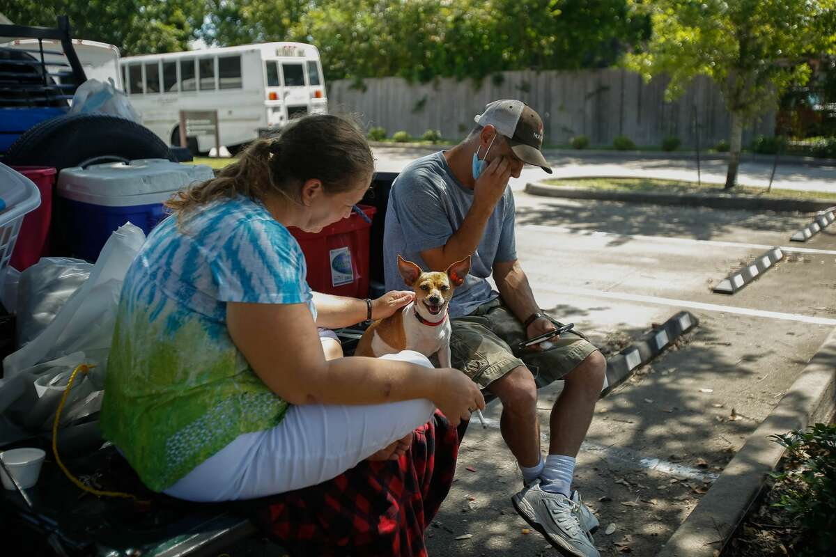 Candy and Michael Dorn sit at their car waiting to hear back about the status of their home in Beaumont. The couple arrived at the Forge on August 25 with their two dogs, Babygirl and Bear.