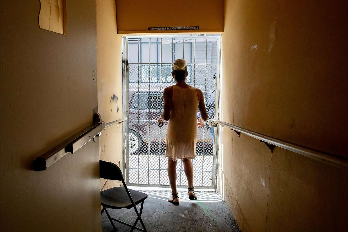 Jasmine Jones walks outside the gate at TGI Justice in San Francisco in August. Jones, a trans woman who was released from custody in May, was housed with male inmates during her 17-year sentence, despite her pleas to be housed with other women.