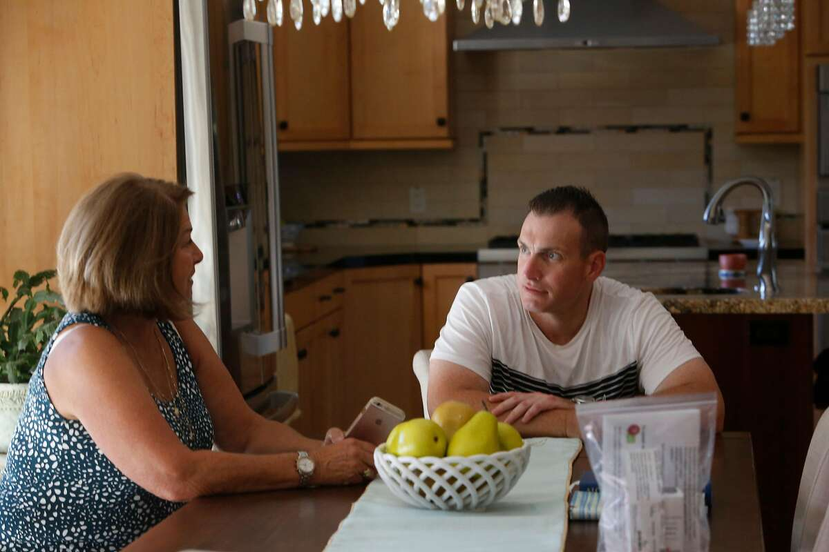 Jeffrey Choate (right) and his mother Sue Choate Brye (left) talk as they sit in the dining room at their home on Tuesday, August 11, 2020 in Clayton, Calif.
