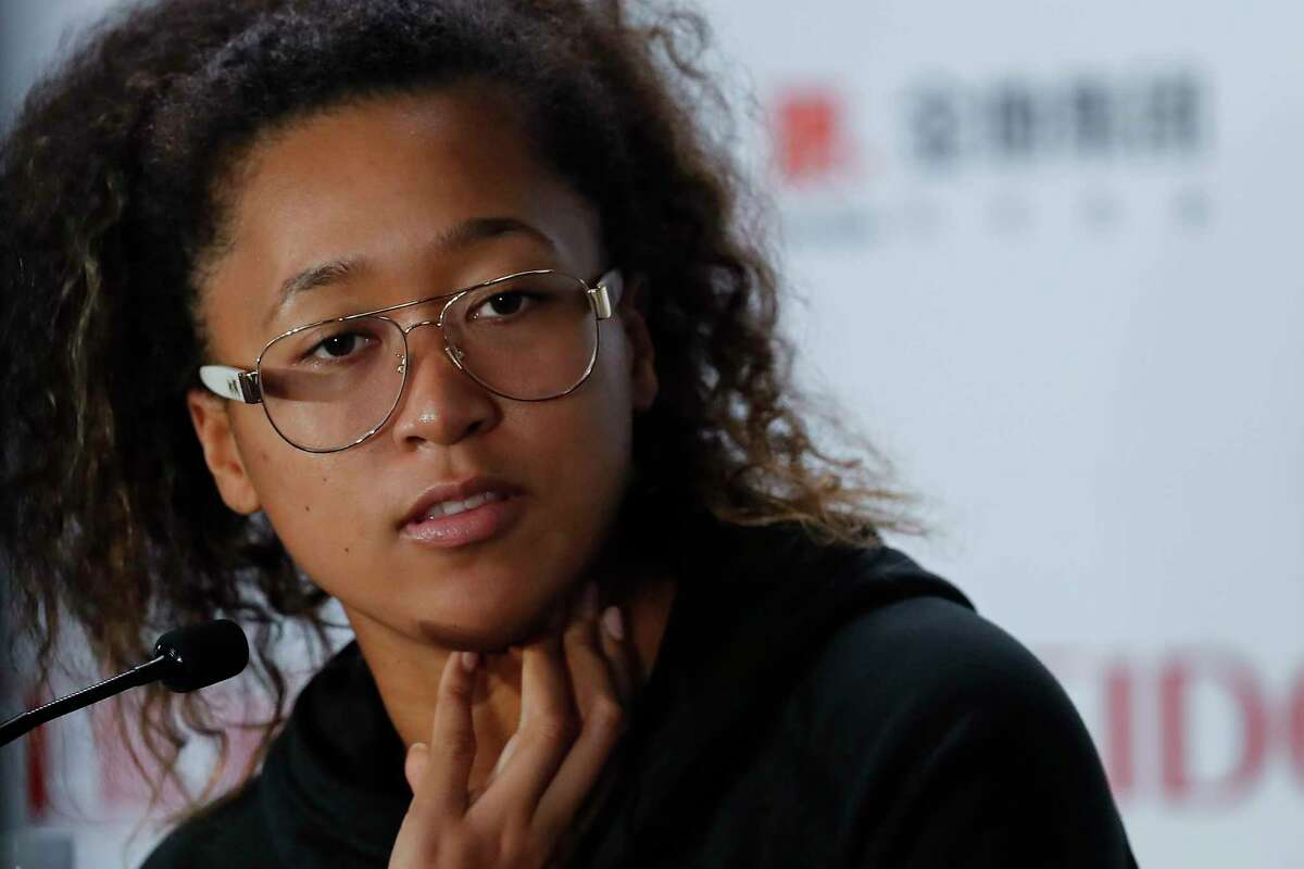 FILE - In this Oct. 29, 2019, file photo, Naomi Osaka of Japan speaks during a press conference at the WTA Finals Tennis Tournament in Shenzhen, China's Guangdong province. Naomi Osaka will play in the Western & Southern Open semifinals, after all. A day after saying she would withdraw from the hard-court event to protest a€œthe continued genocide of Black people at the hand of the police