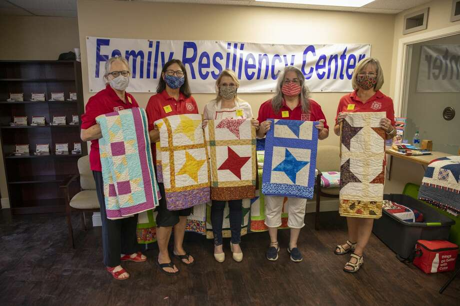Midland Quilters Guild members Andrea Green, from left, Pat Connally, Kim Saba, president Rachel Garibay and Chris Hammit post for a photo with quilts Thursday, Aug. 27, 2020 at the Family Resiliency Center. Photo: Jacy Lewis/Reporter-Telegram / MRT