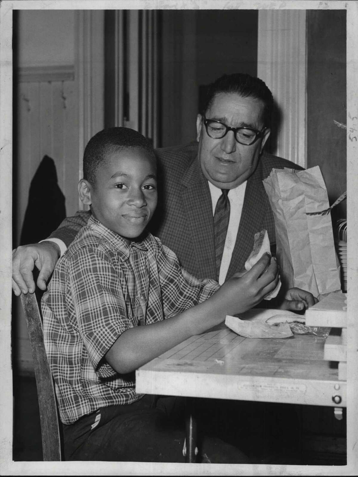 School 7 Principal Sam DiBlasi with Paul Willis, Albany, New York - hot lunches at public schools. January 06, 1965 (Jack Madigan/Times Union Archive)
