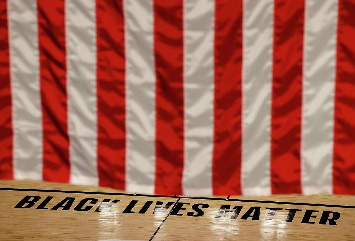The Black Lives Matter logo is seen on an empty court as all NBA playoff games were postponed today during the 2020 NBA Playoffs at AdventHealth Arena at ESPN Wide World Of Sports Complex on August 27, 2020 in Lake Buena Vista, Florida. NBA players have reportedly decided to resume the season after their walkout of playoff games on Wednesday to protest the shooting of Jacob Blake in Kenosha, Wisconsin. (Photo by Kevin C. Cox/Getty Images)