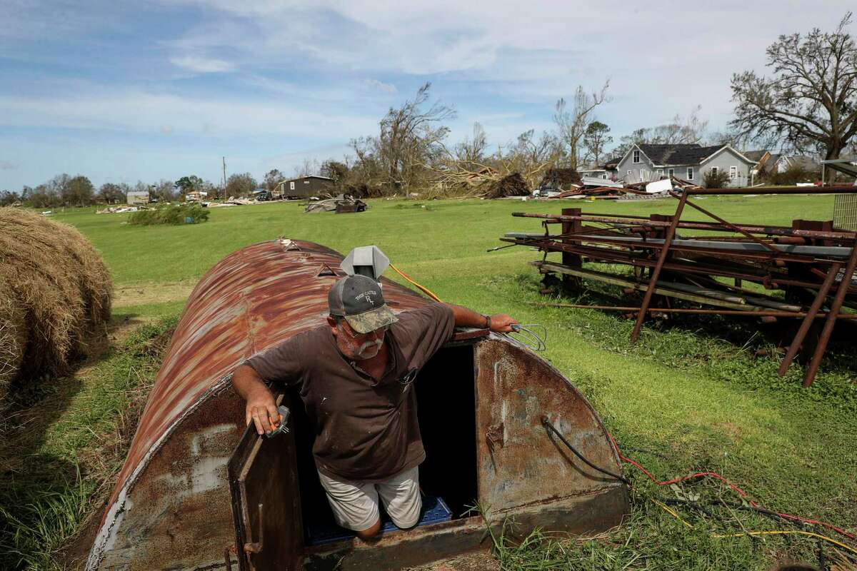 Ricky Thibadeaux emerges from a storm shelter where he and six others sheltered from Hurricane Laura on Thursday, Aug. 27, 2020, in Grand Lake, La.