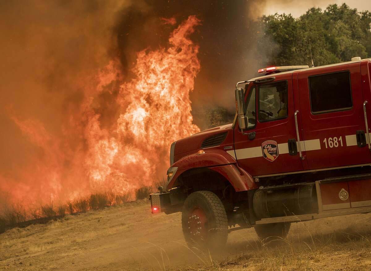A backburn on Buck Mountain is used to help fight the Carmel Fire near Carmel Valley, Calif., Wednesday, Aug. 19, 2020. (AP Photo/Nic Coury)