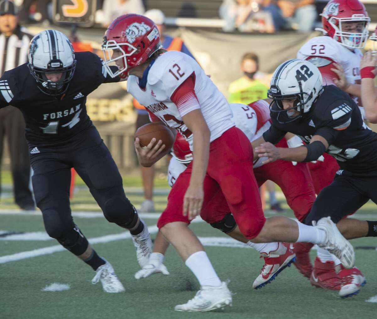Coahoma's Kolt Redden tries to pick his way through the line and get away from Forsan's Ernesto Rivera, 42, 8/27/2020 at Big Spring Memorial Stadium. Tim Fischer/Reporter-Telegram
