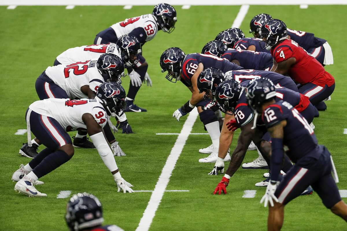 Houston Texans quarterback Deshaun Watson (4) takes a snap from center Nick Martin (66) during an NFL training camp football practice Thursday, Aug. 27, 2020, in Houston.