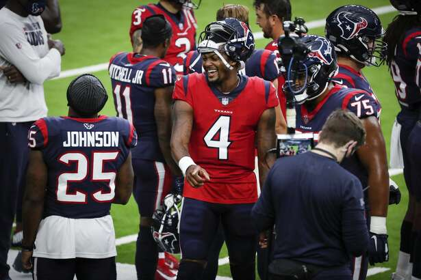 Houston Texans quarterback Deshaun Watson (4) laughs with running back Duke Johnson (25) on the sidelines during an NFL training camp football practice Thursday, Aug. 27, 2020, in Houston.