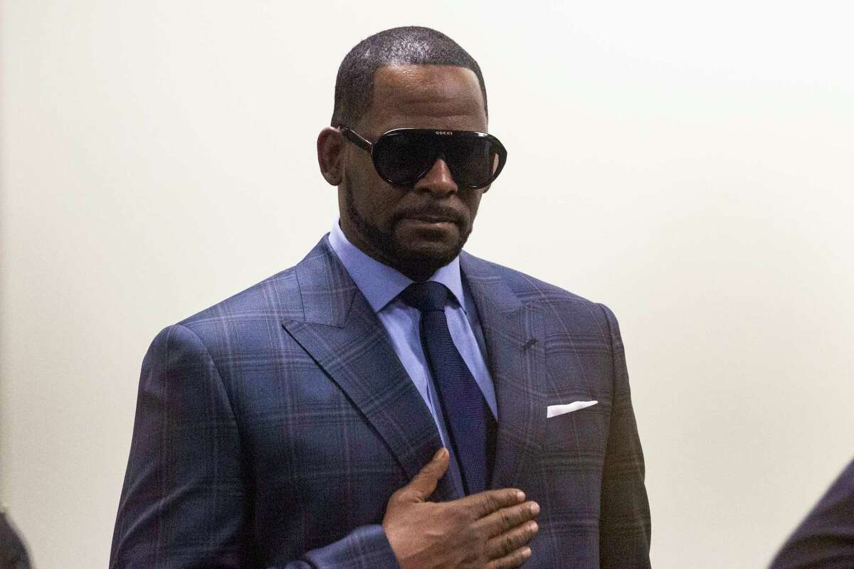 FILE - Musician R. Kelly arrives at the Daley Center for a hearing, Wednesday, March 6, 2019, in Chicago. The lawyer for R. Kelly says the R&B singer, who is awaiting trial on child pornography and other charges, was assaulted by a fellow detainee at the Metropolitan Correctional Center in Chicago. Attorney Steve Greenberg says in a Thursday, Aug. 27, 2020 tweet that he learned of the attack on his client Wednesday. (Ashlee Rezin/Chicago Sun-Times via AP, file)