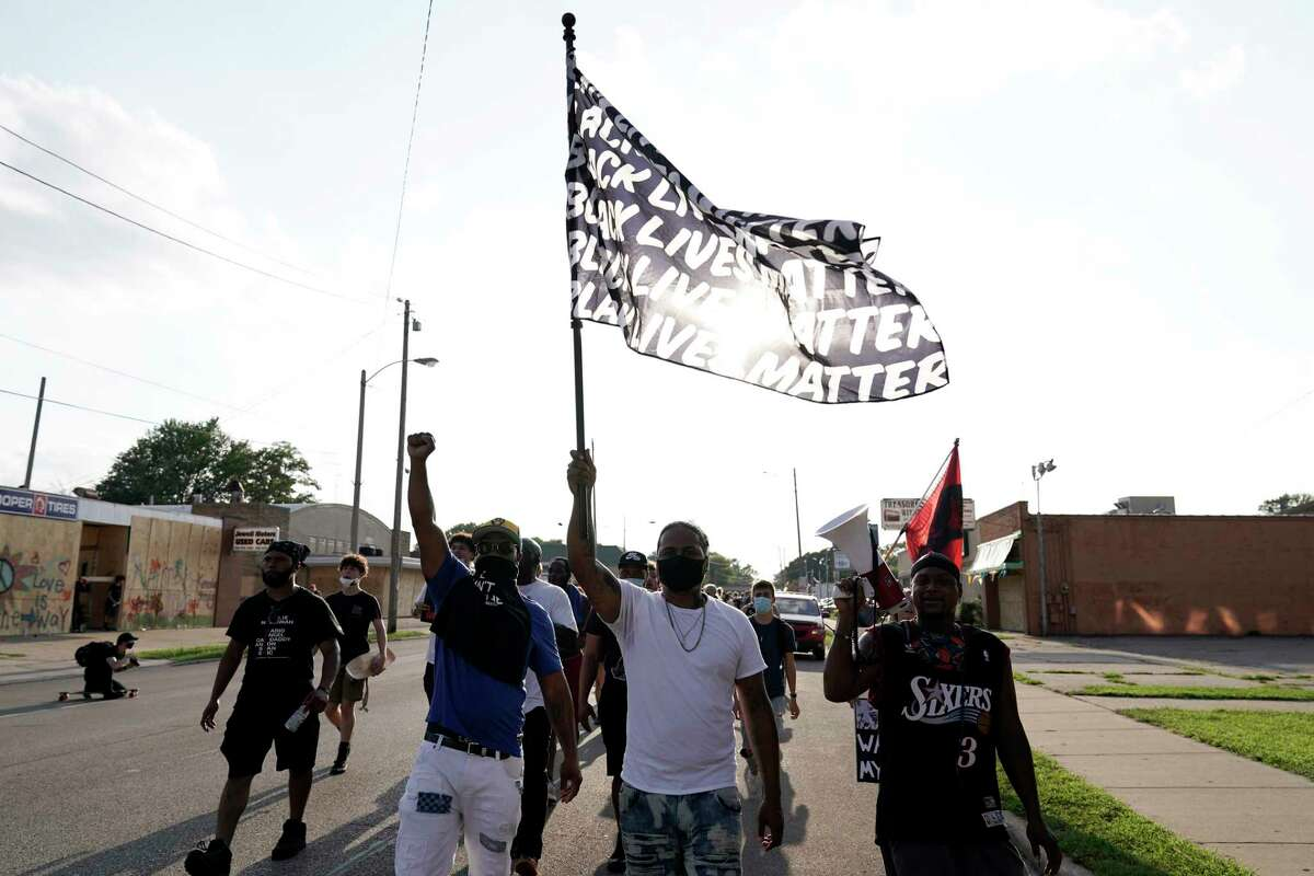 Protesters prepare to march against the police shooting of Jacob Blake, Thursday, Aug. 27, 2020, in Kenosha, Wis. (AP Photo/Morry Gash)