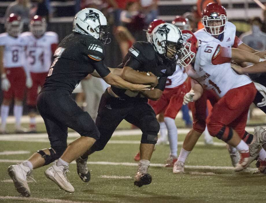 Forsan's Major Stockton hands off to Nathaniel Hernandez 8/27/2020 at Big Spring Memorial Stadium as they battle Coahoma. Tim Fischer/Reporter-Telegram Photo: Tim Fischer/Midland Reporter-Telegram