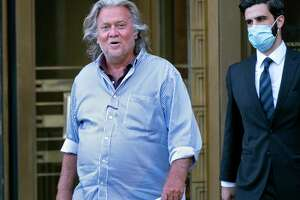President Donald Trump's former chief strategist Steve Bannon leaves federal court in New York on Aug. 20 after pleading not guilty to charges that he ripped off donors to an online fundraising scheme to build a Southern border wall.