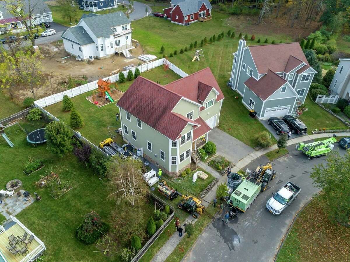 An overhead shot of a house with a Dandelion Energy geothermal system.