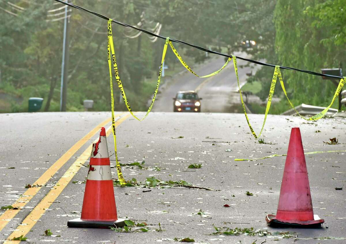Lines down on Pine Orchard Road on Aug. 28, the morning after Branford was hard hit by a fierce storm with severe thunderstorms and high winds throughout the evening ripping down trees and wires. A majority of power outages were in the towns hit hardest by Thursday's storm: Branford, Hamden and North Haven. It is believed a tornado may have touched down.