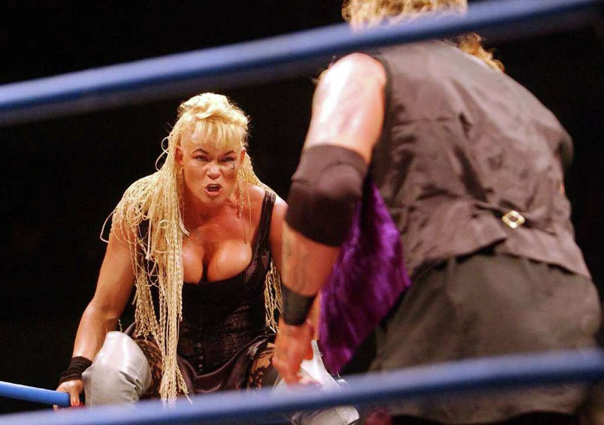"""Photo by Chris McGrath/ALLSPORT Luna Vachon eyes off the Vampire Warrior during the Black Wedding match at the WWA Wrestling """"Inception"""" fight night held at the Sydney Superdome, Sydney, Australia on October 26, 2001. Mandatory Credit:"""
