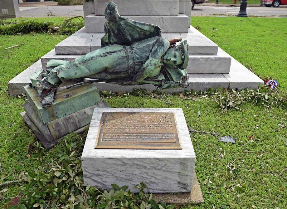 A confederate statue sits toppled in front of the Calcasieu Parish Courthouse on Ryan Street after Hurricane Laura made landfall as a Category 4 storm Thursday, Aug. 27, 2020 in Lake Charles, La. (Hilary Scheinuk/The Advocate via AP) Photo: HILARY SCHEINUK, Associated Press / © 2020 The Advocate