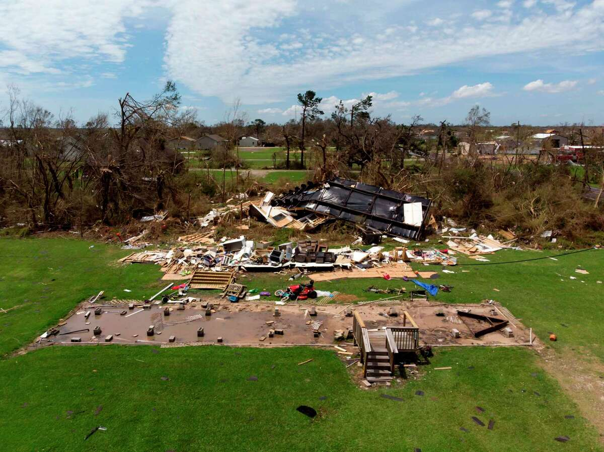 TOPSHOT - This aerial view shows homes damaged by Hurricane Laura on August 27, 2020, in Grand Lake, Louisiana. - Hurricane Laura slammed into the southern US state of Louisiana Thursday and the monster category 4 storm prompted warnings of