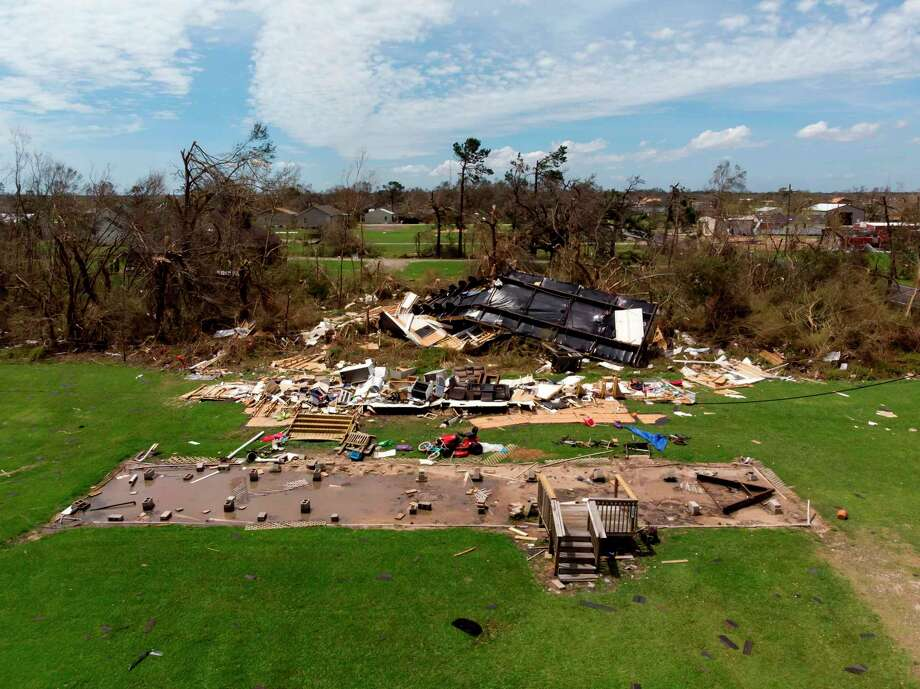 "TOPSHOT - This aerial view shows homes damaged by Hurricane Laura on August 27, 2020, in Grand Lake, Louisiana. - Hurricane Laura slammed into the southern US state of Louisiana Thursday and the monster category 4 storm prompted warnings of ""unsurvivable"" ocean surges and evacuation orders for hundreds of thousands of Gulf Coast residents. The National Hurricane Center (NHC) said ""extremely dangerous"" Laura would bring winds of 150 miles per hour (240 kilometers per hour) and ""destructive waves will cause catastrophic damage"" to Louisiana and Texas. (Photo by STRINGER / AFP) (Photo by STRINGER/AFP via Getty Images) Photo: STRINGER, Contributor / AFP Via Getty Images / AFP or licensors"