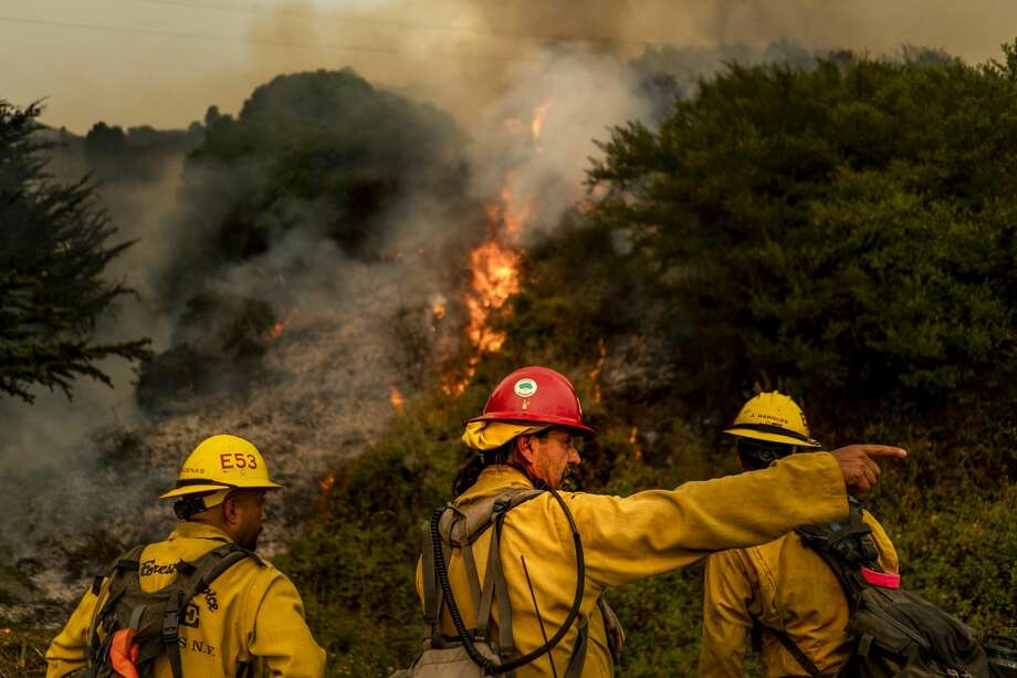 """Battling the Dolan Fire along the central California coast, Los Padres National Forest fire fighters implement a """"back-fire"""" method to burn off underbrush to protect residential structures in Big Sur. Photo: The Washington Post/The Washington Post Via Getty Im / 2020 The Washington Post"""