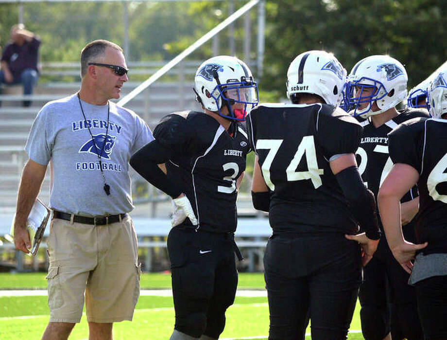 Liberty Middle School coach Paul Johnes talks to his team during the Orange and Black Scrimmage last year inside the District 7 Sports Complex. Photo: Scott Marion|The Intelligencer