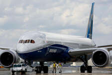 Boeing employees walk the new Boeing 787-10 Dreamliner down towards the delivery ramp area at the company's facility in South Carolina after conducting it's first test flight at Charleston International Airport in North Charleston, S.C., Friday, March 31, 2017.