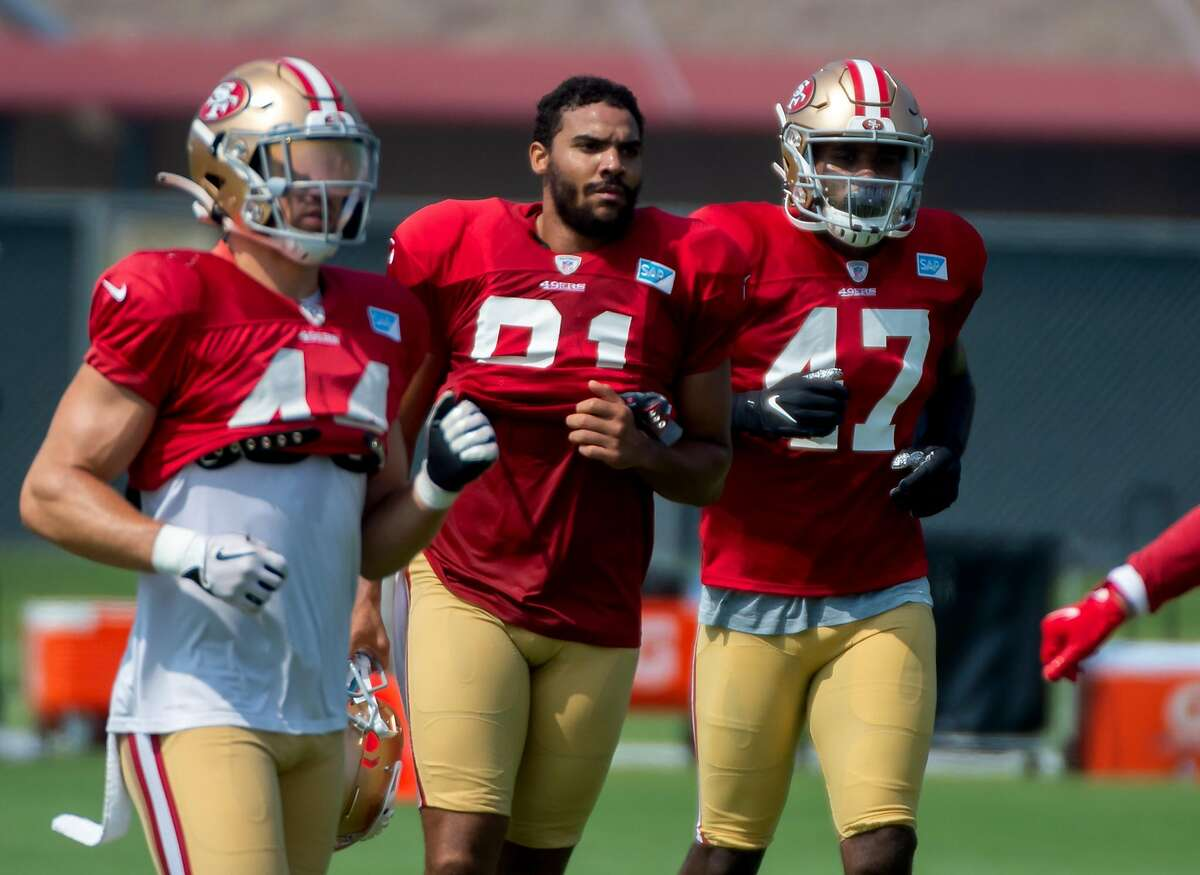 San Francisco 49ers tight end Jordan Reed (81), fullback Kyle Juszczyk (44) and tight end Eric Swoope (47) jog to a practice field during training camp at Levi's Stadium on Tuesday, Aug. 25, 2020 in Santa Clara.