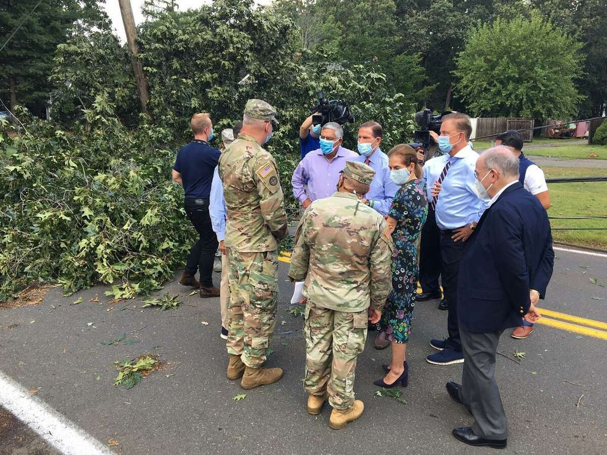 Gov. Ned Lamont and others meet with officials onLaydon Avenue in North Haven to survey storm damage and discuss clean up efforts.