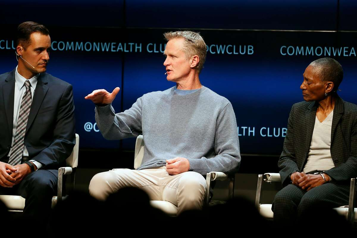 Steve Kerr speaks as Mike McLively and Thea James, MD, listen during Commonwealth Club Destination Health: Preventing Gun Violence panel discussion in San Francisco, Calif., on Wednesday, February 19, 2020.