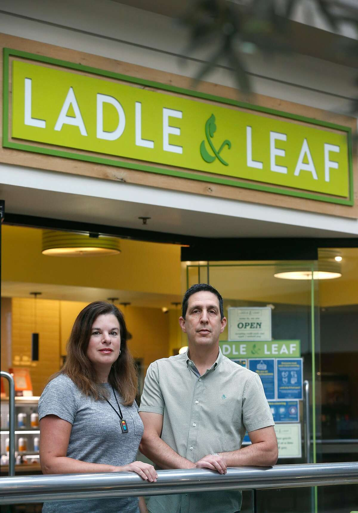 Business partners Jennifer Sarver and Steve Sarver prepare their Ladle and Leaf cafe and restaurant for lunch service in the Crocker Galleria mall in San Francisco, Calif. on Tuesday, Aug. 25, 2020. Some businesses have remained open despite few office workers and commuters populating the Financial District during the coronavirus shutdown.