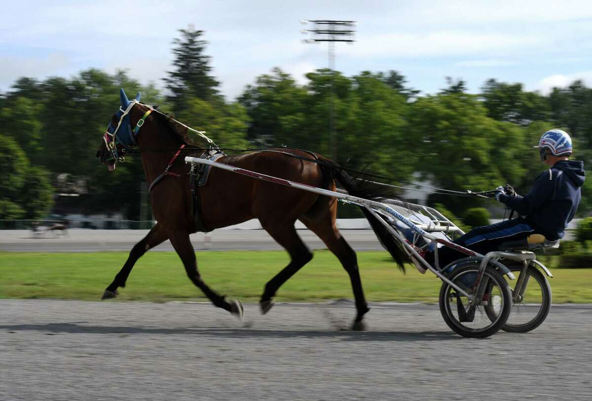 Standardbreds are taken out for morning work at the Saratoga Harness Racing at Saratoga Casino facility on Friday, Aug. 28, 2020, in Saratoga Springs, N.Y. The state said April 14, 2021 that fans (at 20 percent capacity) can go back to the track Friday, April 23, 2021. (Will Waldron/Times Union)
