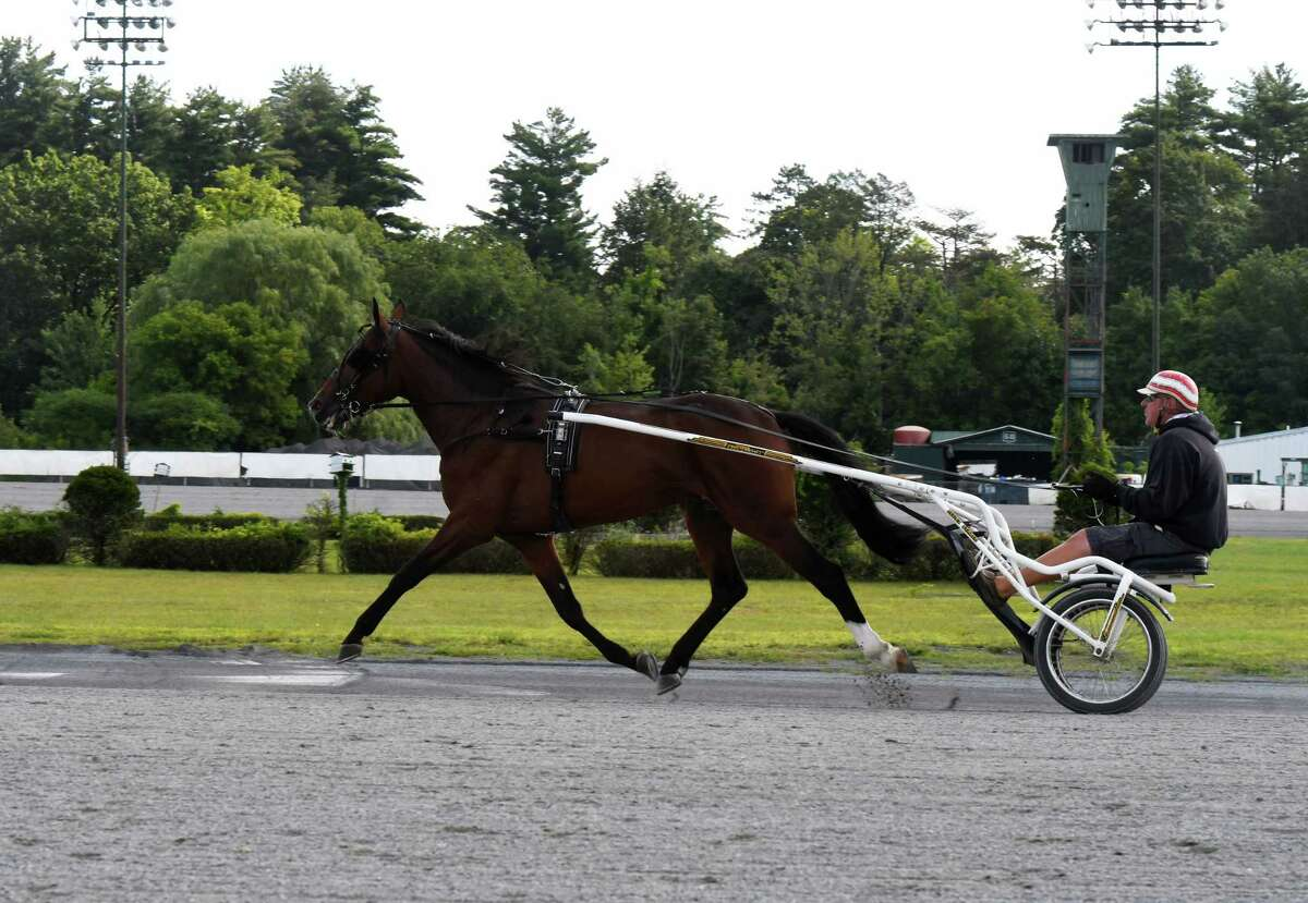 Standardbreds are taken out for morning work at the Saratoga Harness Racing at Saratoga Casino facility on Friday, Aug. 28, 2020, in Saratoga Springs, N.Y. (Will Waldron/Times Union)