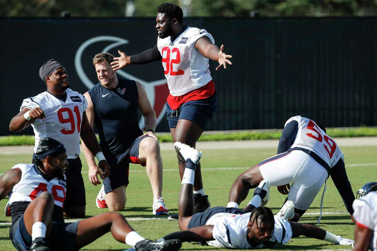 Texans nose tackle Brandon Dunn (92) doubles as the locker room D.J., keeping the tunes fresh and the inside jokes going with his teammates.