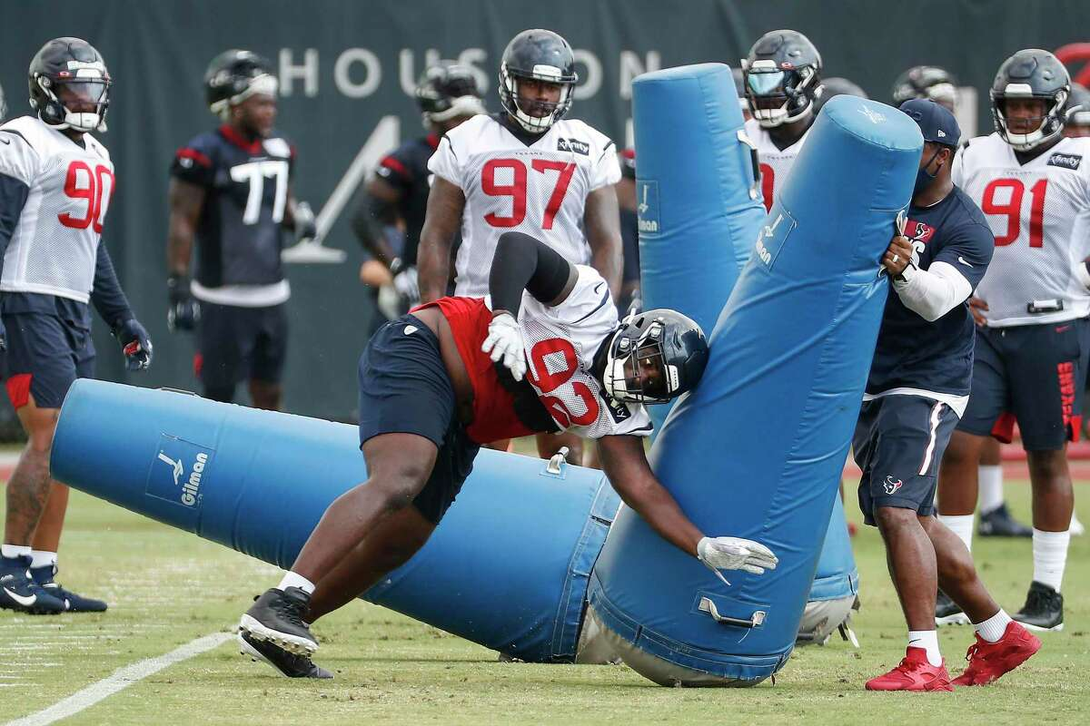 Houston Texans nose tackle Brandon Dunn (92) runs through a line of blocking dummies during an NFL training camp football practice Friday, Aug. 21, 2020, in Houston.