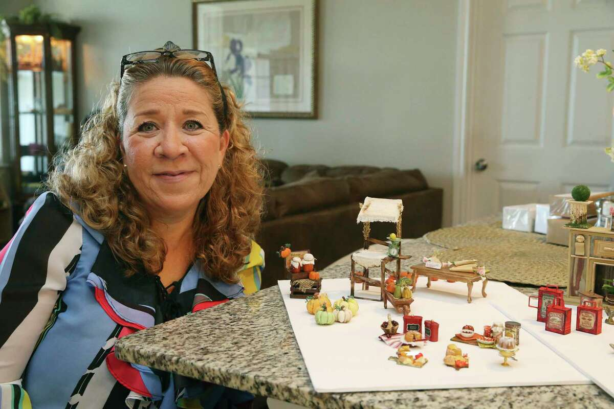 Vicky Ramirez shows several miniature dollhouse items made by her sister Laura Ramirez. Laura, who lives in Ciudad Juárez, Mexico, makes the pieces by hand at 1:12 scale, then mails them to Vicky to help finish with paints and post online to sell.