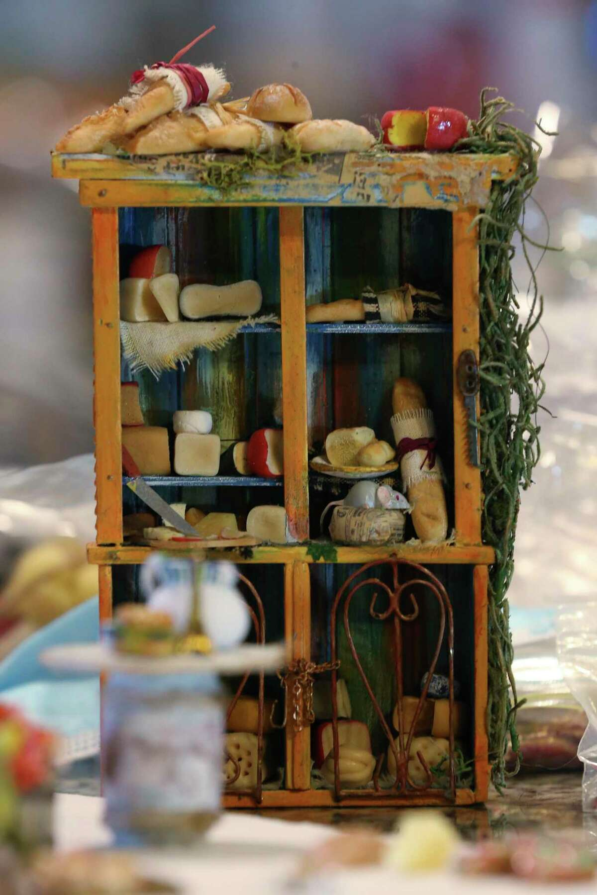 A miniature cheese pantry by artist Laura Ramirez, who lives in Mexico. Ramirez developed her miniature making skills at the former My Doll House shop in Alamo Heights.