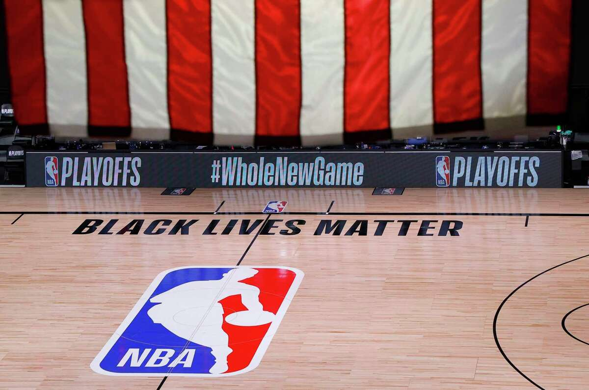 FILE - An empty court and bench are shown following the scheduled start time of Game 5 of an NBA basketball first-round playoff series, Wednesday, Aug. 26, 2020, in Lake Buena Vista, Fla. The NBA playoffs will resume Saturday after the league and the National Basketball Players Association detailed the commitments that made players comfortable continuing the postseason. In a joint statement released Friday, the sides say they will immediately establish a social justice coalition, made up of players, coaches and owners, that would focus on issues such as voting access and advocating for meaningful police and criminal justice reform. (Kevin C. Cox/Pool Photo via AP, File)
